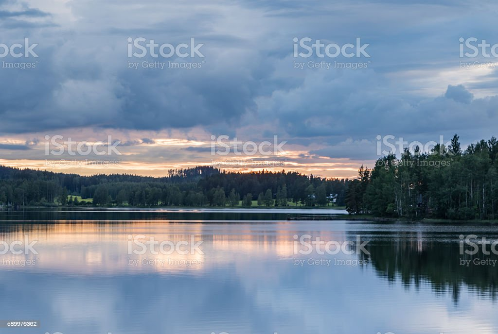 Summer night by a lake stock photo