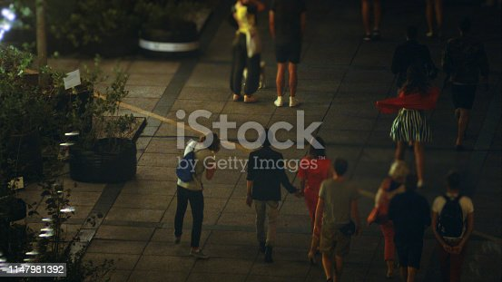 A crowd of people having fun on summer night