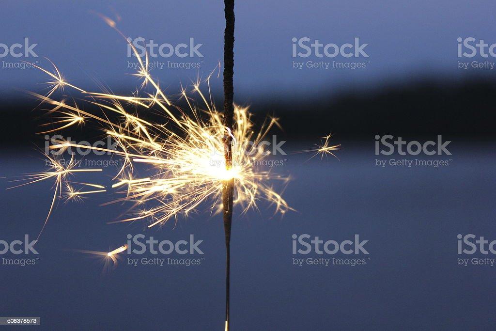 Summer night sparkler stock photo