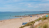 istock Summer on the beach at Hengistbury Head in Dorset 1255893200
