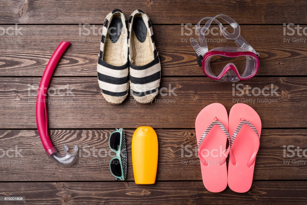Summer or beach accessories on wooden table. stock photo