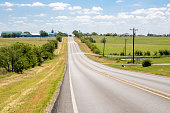istock Summer or spring view of country road side with farmer land in Justin Texas 1263039166