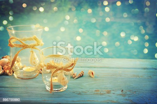 Summer outdoor decoration with sea shell and candles