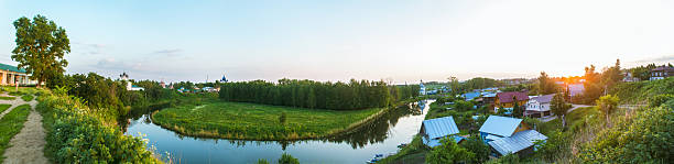 Summer panorama of the village by the river stock photo