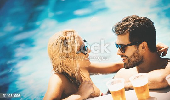 istock Summer party in a pool. 511934996