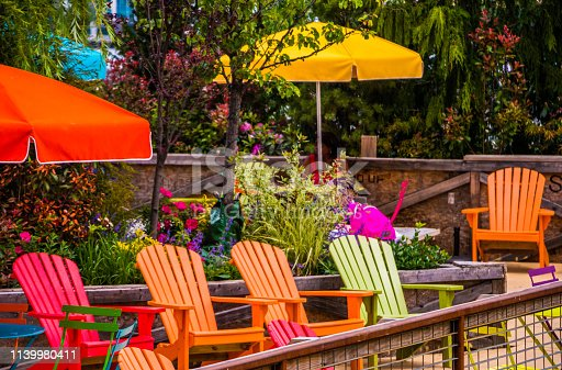 A Vibrant Patio In A Public Park Along The harbor Front With Painted Colorful Wooden Deck Chairs And Umbrellas In The Summer