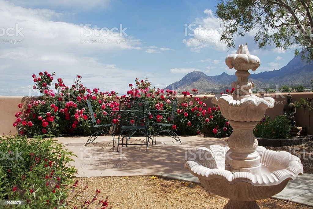 Summer Patio with Metal Table and Spanish Fountain stock photo