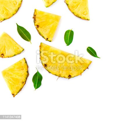 Summer Pattern with Slices of Pineapple Isolated. Exotic fruit Pineapple chunks  on white background. Flat lay. Summertime concept