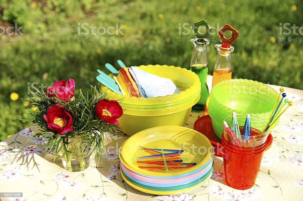 Summer picnic plastic accessories, plates and dishes royalty-free stock photo