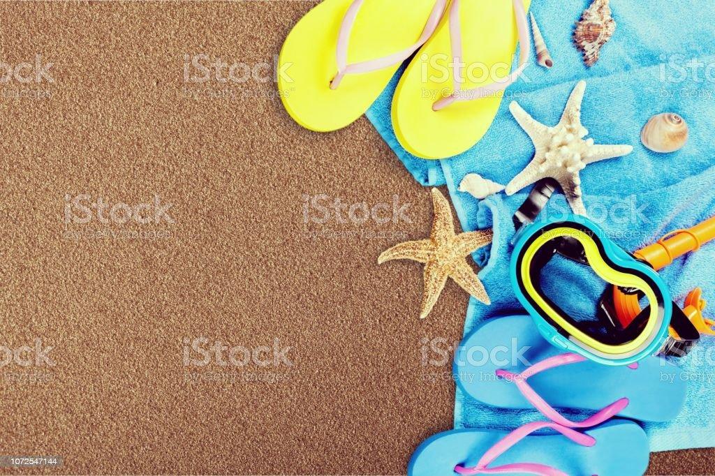 Beach accessories on wooden background. Flip flops, scuba mask, sea...
