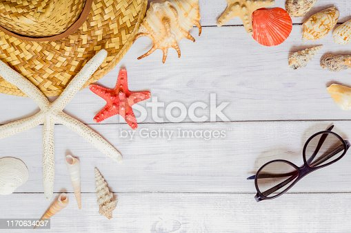 Seashells and starfish over white wooden floor