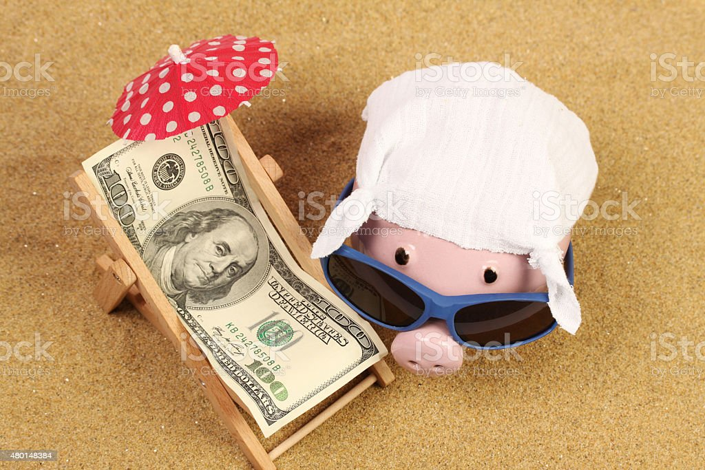Summer piggy bank with sunglasses and hankie and beach chair stock photo