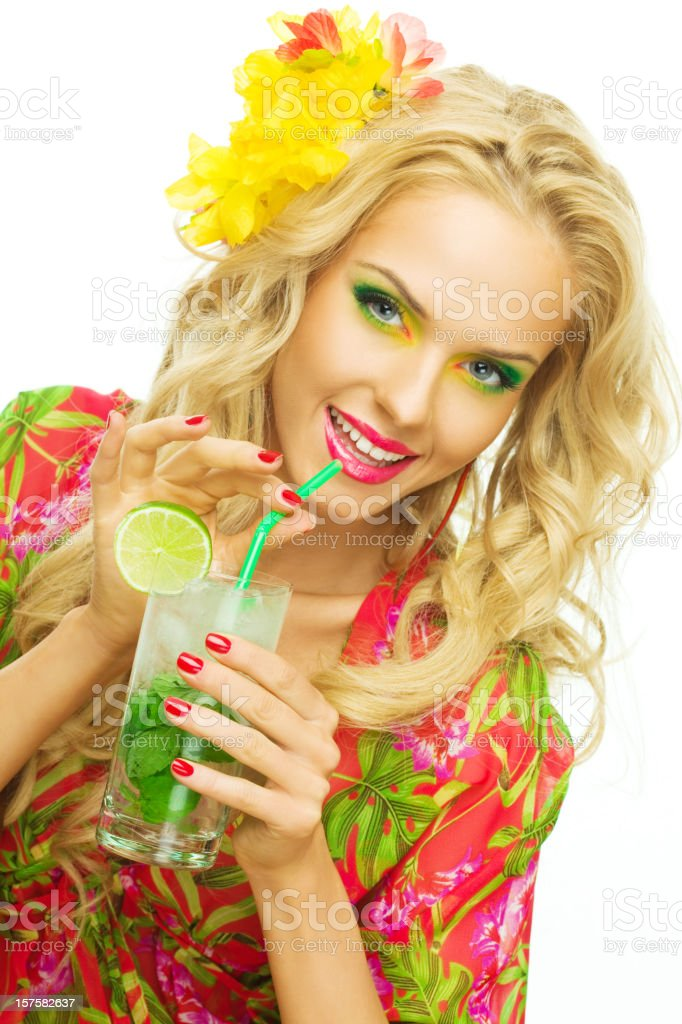 Summer portrait of a beautiful blonde woman drinking tropical drink  20-24 Years Stock Photo