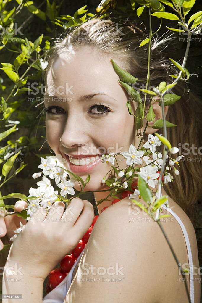 Summer portrait of a beautiful young woman with flowers royalty-free stock photo