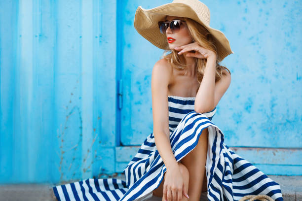 Summer portrait of a woman in a straw hat stock photo