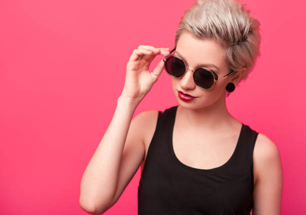 summer portrait of an attractive young woman in sunglasses stock photo