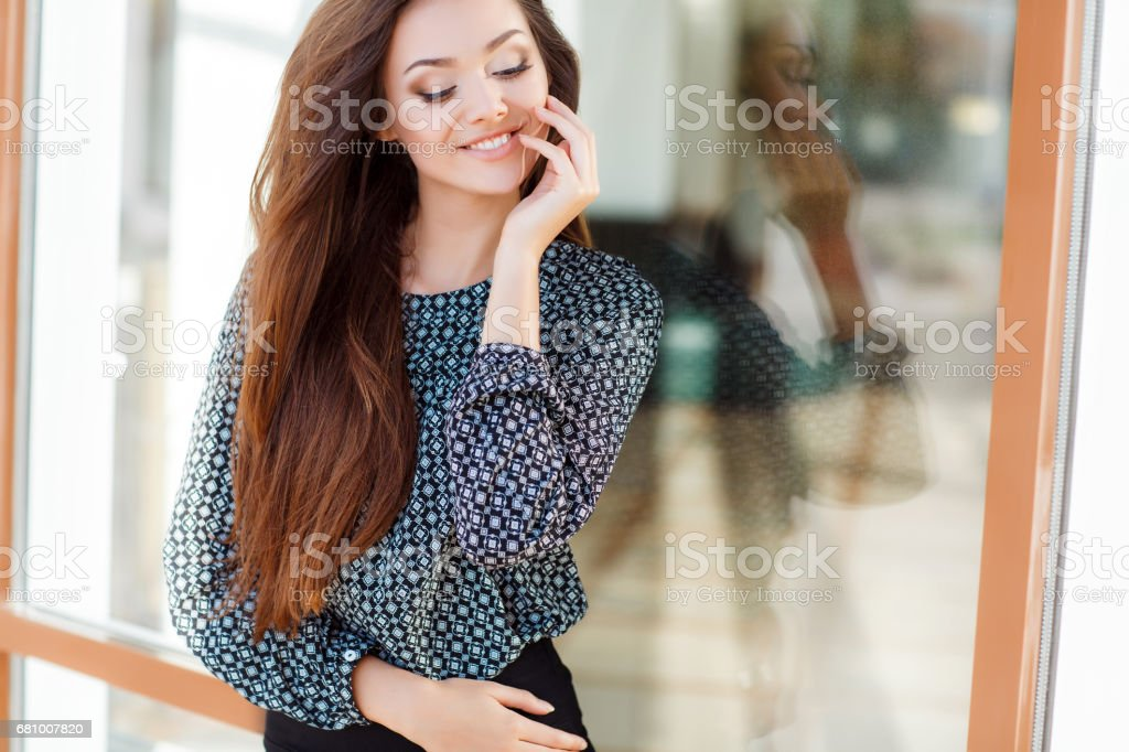 Summer portrait of beautiful woman in town in the summer royalty-free stock photo