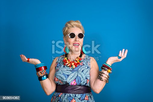 istock Summer portrait of creative senior woman 903654062