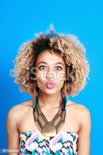521083232istockphoto Summer portrait of energetic afro american young woman 521083542