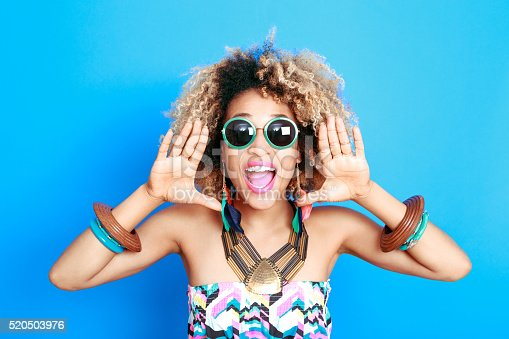 521083232istockphoto Summer portrait of excited afro american young woman 520503976