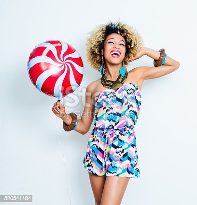 521083232istockphoto Summer portrait of excited afro american young woman 520541184