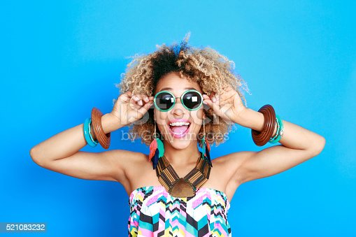 istock Summer portrait of excited afro american young woman 521083232