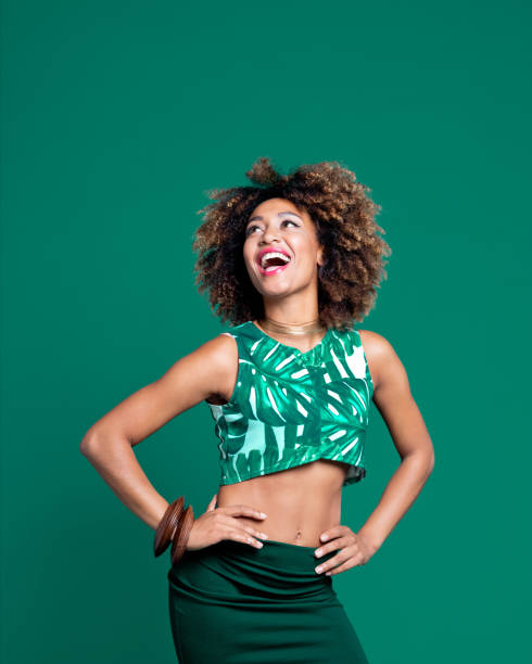 summer portrait of excited afro young woman against green background - coloured background stock photos and pictures