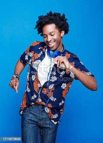 istock Summer portrait of funky young man in hawaiian shirt 1214670640