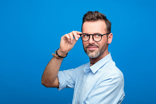 Summer Portrait Of Handsome Man Blue Background Stock Photo - Download Image Now