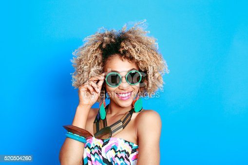 521083232istockphoto Summer portrait of happy afro american young woman 520504260