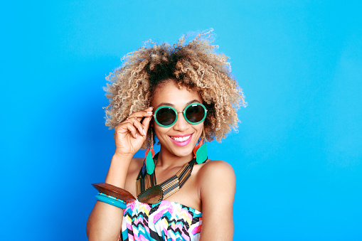 1062933270 istock photo Summer portrait of happy afro american young woman 520504260