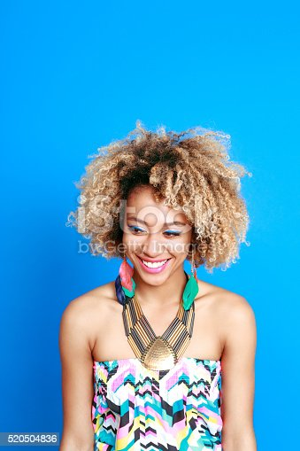 521083232istockphoto Summer portrait of happy afro american young woman 520504836