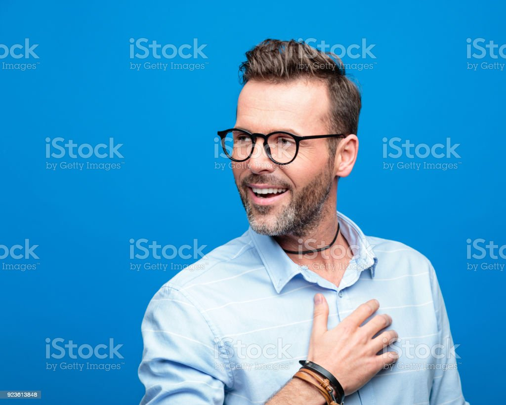 Summer portrait of happy man, blue background Summer portrait of happy, handsome man wearing blue shirt and glasses. Studio shot, blue background. 30-39 Years Stock Photo