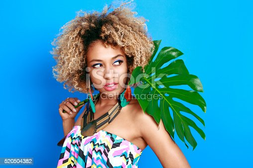 istock Summer portrait of sensual afro american young woman 520504382