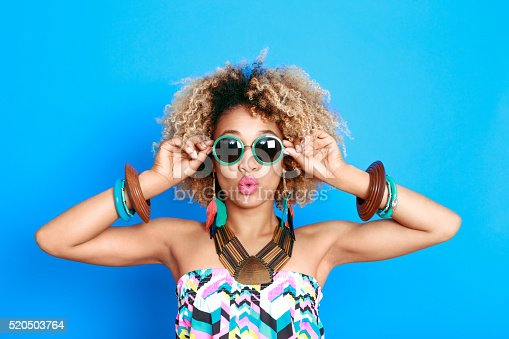 521083232istockphoto Summer portrait of surprised afro american young woman 520503764