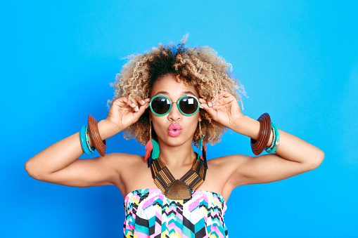 1062933270 istock photo Summer portrait of surprised afro american young woman 520503764