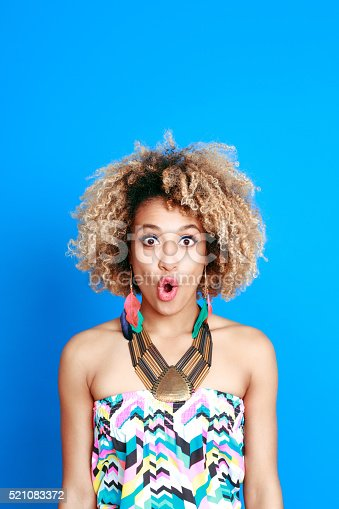 521083232istockphoto Summer portrait of surprised afro american young woman 521083372
