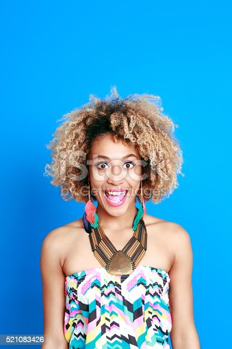 521083232istockphoto Summer portrait of surprised afro american young woman 521083426