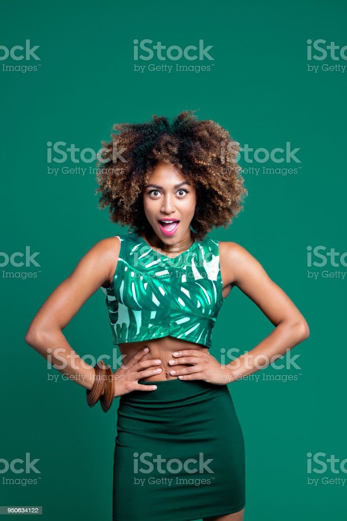 Summer portrait of surprised afro american young woman stock photo