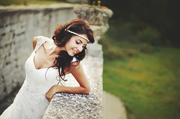 summer portrait of young   brunette bride stock photo