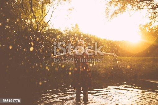 700603062istockphoto Summer rain fun 586191778