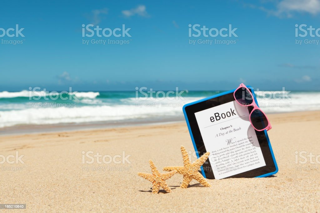 Summer Reading with e-Book e-reader Tablet Computer on the Beach royalty-free stock photo