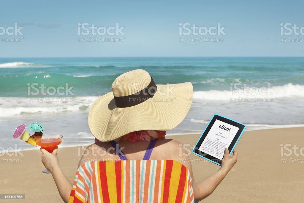 Summer Reading with eBook Tablet Computer on the Tropical Beach royalty-free stock photo