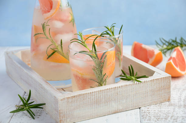 summer refreshing drink with grapefruit and rosemary - grapefruit cocktail stock photos and pictures