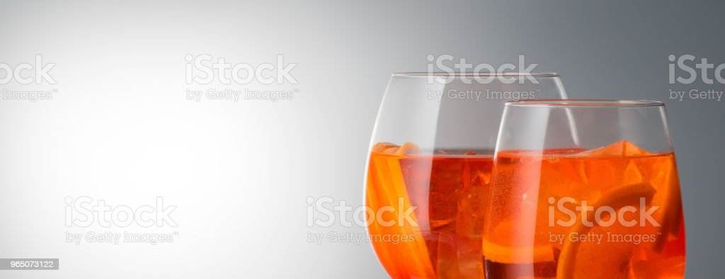 Summer refreshing faintly alcoholic cocktail Aperol spritz in a royalty-free stock photo
