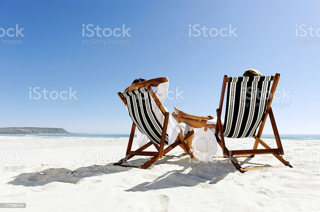 summer relaxing beach couple stock photo