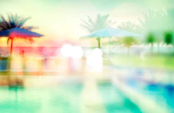 Summer resort view blurred background. Summer tourist tropical resort blurred background.Travel concept backdrop. beach party stock pictures, royalty-free photos & images