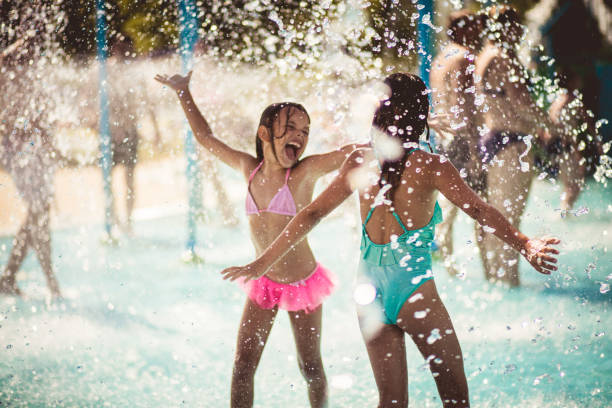 summer rocks! - children play water park stock photos and pictures