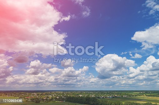 1155573645 istock photo Summer rural landscape, aerial view. View of green fields and village 1210993436