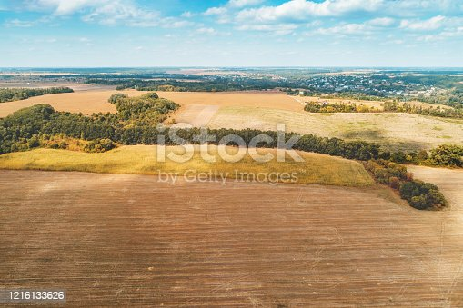 1155573645 istock photo Summer rural landscape. aerial view. View of plowed fields with beautiful sky 1216133626